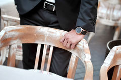 Black suit groom with hand and wristwatch Stock Image