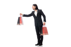 The black suit man holding plastic bags isolated on white Stock Images