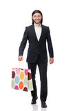 The black suit man holding plastic bags isolated on white Royalty Free Stock Photos