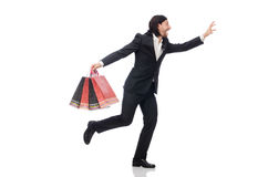 The black suit man holding plastic bags isolated on white Stock Photo