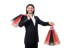 Black suit man holding plastic bags isolated on white Stock Images