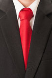 Black suit and red tie Royalty Free Stock Photography