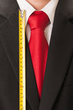 Black suit, red tie, white shirt and centimeter Stock Image