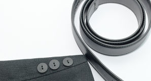 Black suit sleeve and belt. Black suit sleeve and belt on white background Royalty Free Stock Photos