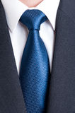 Black suit, white shirt and blue tie Royalty Free Stock Photography