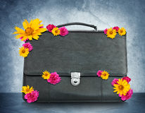 Black suitcase with flowers Royalty Free Stock Photo