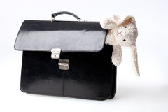 Black suitcase with white bunny toy Stock Photography