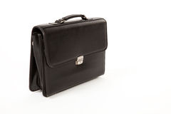 Black Suitcase on a White Isolated Background. Black Closed Suitcase with a Handle on a White Isolated Background Royalty Free Stock Photography