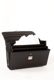 Black Suitcase on a White Isolated Background. Black Suitcase with Paperwork on a White Isolated Background Royalty Free Stock Photography