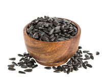 Black sunflower seeds in bowl isolated on white background Royalty Free Stock Images