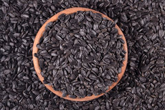 Black sunflower seeds in a  bowl Stock Photos