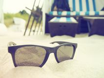 Black sunglasses on beach Stock Image