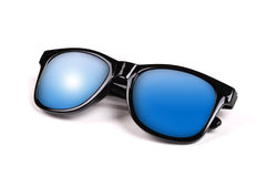 Black sunglasses with blue sky reflection Royalty Free Stock Photos