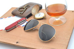 Black sunglasses and Glass of brandy. Stock Photos