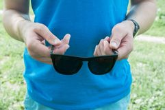 Black sunglasses in hand royalty free stock photography