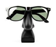 Black sunglasses on holder isolated on white Stock Photo