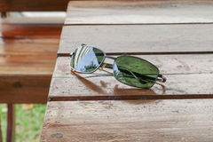 Black sunglasses on a wooden table Stock Photo