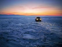 Black Suv on Snow during Golden Hour royalty free stock images