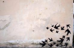 Black swallows. Nblack Swallows on white wire royalty free stock photos