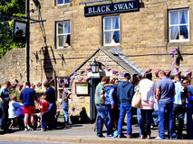 Black Swan pub, Ashover Carnival. The busy local pub at the Ashover Carnival, Derbyshire, Peak District National Park, England, UK Royalty Free Stock Images