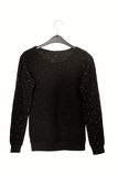 black sweater with golden decor Royalty Free Stock Photo