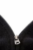 Black Sweater Zipper on White. The zipper of a black sweater open in a V. The background is white for display of text Stock Image