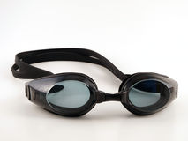 Black Swim Goggles. Tinted black swim goggles await fun in the sun Stock Images