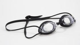 Black Swimming Goggles Side. Black and clear pair of swimming goggles Royalty Free Stock Images