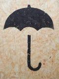 Black symbol on plywood Stock Photos