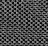 Black symmetrical texture of synthetic fiber. Royalty Free Stock Photos