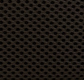 Black symmetrical texture of synthetic fiber. Stock Photos