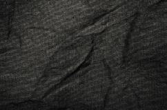 Black synthetic fabric cloth texture detail background. Crumpled fabric texture as background Stock Images