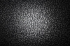 Black synthetic leather. Texture Stock Photos