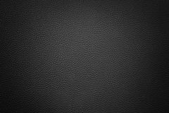 Black synthetic leather  background with vignette. Black red synthetic leather texture background with vignette Royalty Free Stock Image