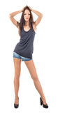 Black t-shirt and blue shorts. A model female dressed in a black tank top and blue shorts,isolated on white Stock Image