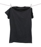 Black t-shirt hanging on clothesline Royalty Free Stock Photo