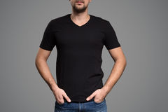 Black t-shirt on a young man template. Gray background. Black t-shirt on a young man template Royalty Free Stock Photo