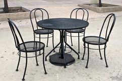 Black table and chair set in public park Royalty Free Stock Photos