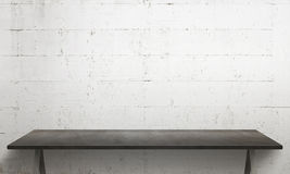 Black table with legs. White wall texture in background Stock Images