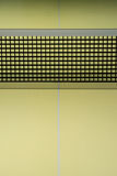 The black table tennis nets on the yellow table tennis table Stock Images