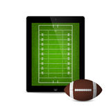 Black tablet with american football ball and field on the screen. Royalty Free Stock Photos