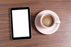 Black Tablet, blank screen and a cup of coffee Royalty Free Stock Photography