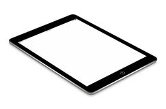 Black tablet computer with blank screen mockup lies on the surfa Stock Image