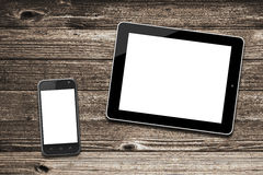 Black tablet computer and smart phone with isolated screens Stock Images