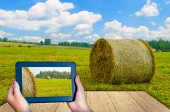 Black tablet on the Hay. With wood floor Royalty Free Stock Photos