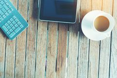 Black tablet ipad on table desk with coffee cup. With copy space royalty free stock photo