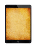 Black tablet PC with grunge wall. royalty free stock photos