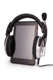 Black tablet PC and headphones (Clipping path) Stock Image