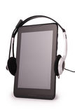 Black tablet PC and headphones (Clipping path) Stock Photography