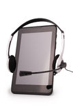 Black tablet PC and headphones (Clipping path) Royalty Free Stock Photo